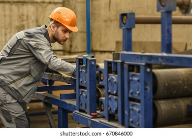 Shot of a young bearded handsome male engineer working at the production plant profession professionalism occupation job operating hardware industry engineer engineering concept