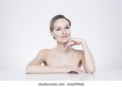 Shot of a young beautiful woman posing against a white background