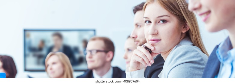 Shot of a young businesswoman looking at the camera during a business meeting
