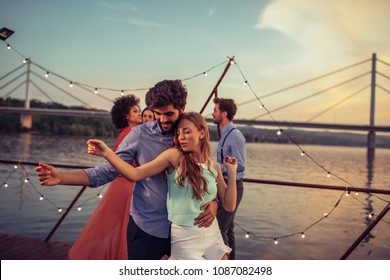 Shot of a young couple dancing on a boat