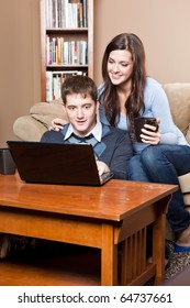 A shot of a young couple working on laptop at home