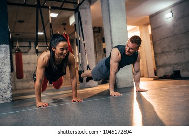 Shot of a young couple working out at the gym
