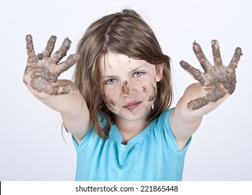 Shot of a Young Girl with Dirty Hands and Face