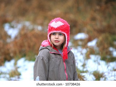 Shot of a young girl frowning in the snow