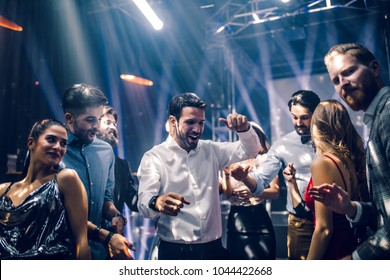 Shot of a young man dancing in the club