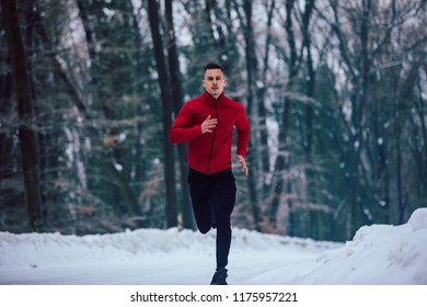 Shot of a young man jogging outdoors