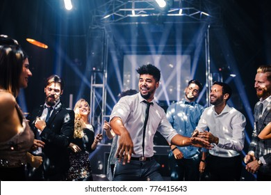 Shot of a young man on the dancefloor with friends
