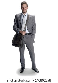 Shot of a young man wearing a suit and shoulder bag.