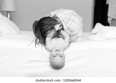 Shot of a young mother bonding with her adorable baby boy at home. Processed in BW
