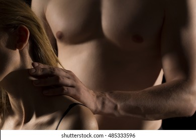 Shot of a young naked man touching her lover's neck