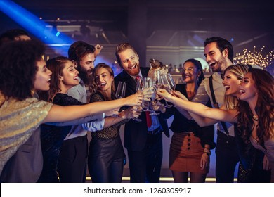 Shot of young people toast in the nightclub