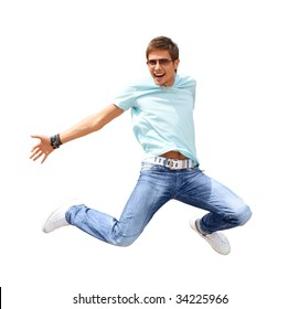 Shot of a young smiling man, that is jumping. He is happy. He is smiling. Isolated on white.