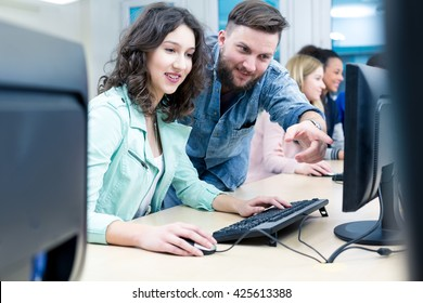 Shot of a young teacher helping an IT student with her work