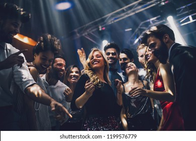Shot of a young woman dancing in the nightclub