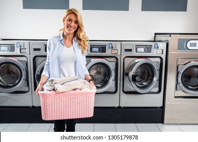 Shot of a young woman doing his weekly washing in a laundromat