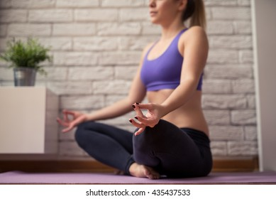 Shot of a young woman doing yoga indoors.