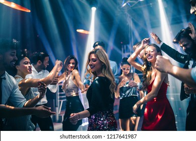 Shot of a young woman on the dancefloor with friends
