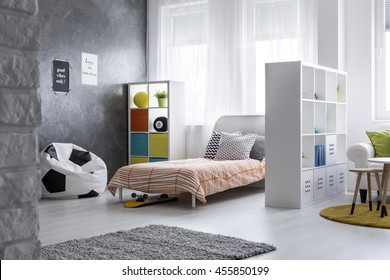 Shot of a yout room with a living room combined with sleeping area