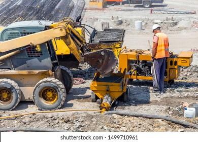 Shotcrete with small concrete pump bunker. Concrete pump for wet sprayed concrete.