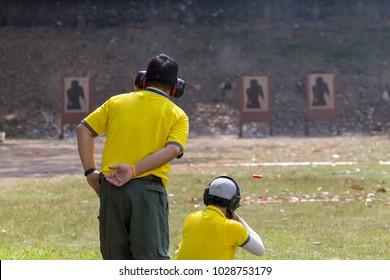 shoter shooting  gun on an outdoor shooting range, selective focus