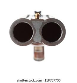 Shotgun aimed at you. Gun control concept. Close up with shallow DOF.
