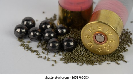 Shotgun ammunition, bullet of shotgun size 12 gauge.