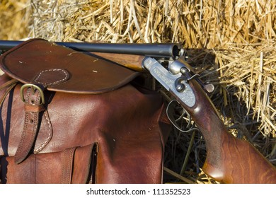 A shotgun and a backpack in the field to hunt