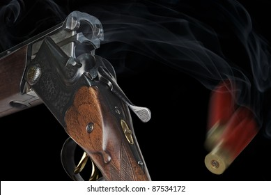Shotgun with cartridges on a black background