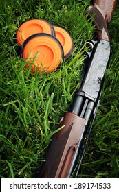 Shotgun and Clay Pigeons