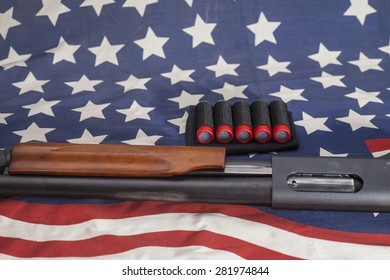 Shotgun on American flag background.