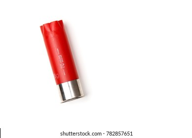 Shotgun shell. Red shotgun shell on a blank (white) background with copy space. Top view.