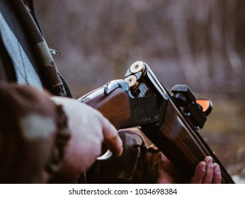 Shotgun shells and shot on black background. Loaded with bullets hunter rifle.
