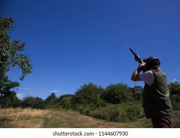 Shotgun shooting on sunny day at gun club