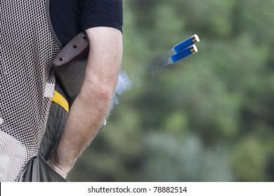 Shotgun throwing its shell
