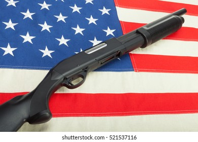 Shotgun without labels on USA flag