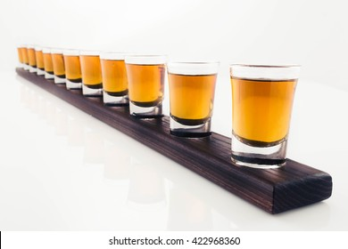 shots on wooden tray isolated on white background