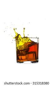shots of whiskey with splash Isolated on white