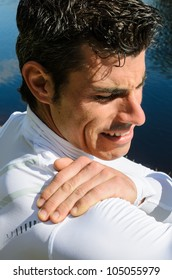 Shoulder pain. Sportsman with shoulder injury because of painful lesion during training.