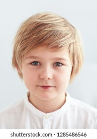 shoulder portrait of cute, nine years old kid, boy for id card