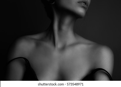 Shoulders and neck of a beautiful girl. Black and white