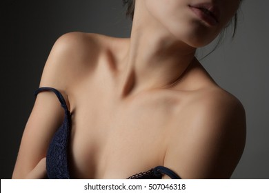 Shoulders and neck of a beautiful young woman. Studio