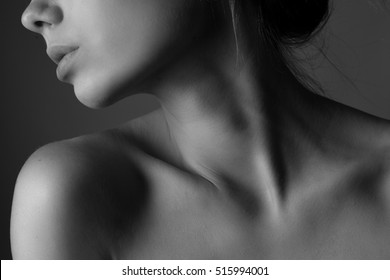 Shoulders and neck of a beautiful young woman. Black and white