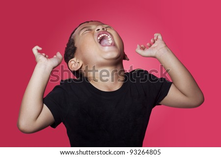 Shouting angry asian kid on red background