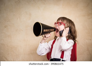 Shouting child businessman with megaphone. Success communication business concept