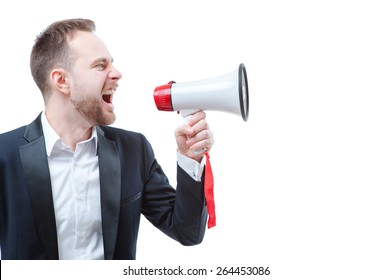 Shouting louder! Studio portrait of young businessman using megaphone. Isolated on white.