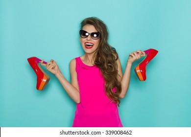 Shouting Woman Holding High Heels