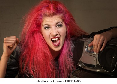 Shouting young lady in pink with clenched fist and radio
