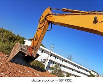 shovel of a bulldozer digging in a construction site