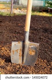 Shovel in field