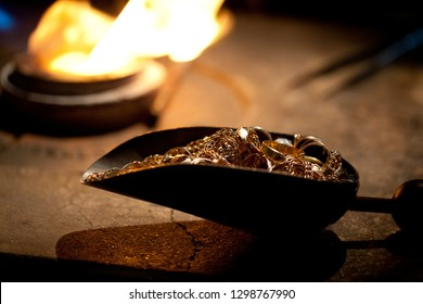 shovel with golden pieces prepared to melt in metallurgical furnace